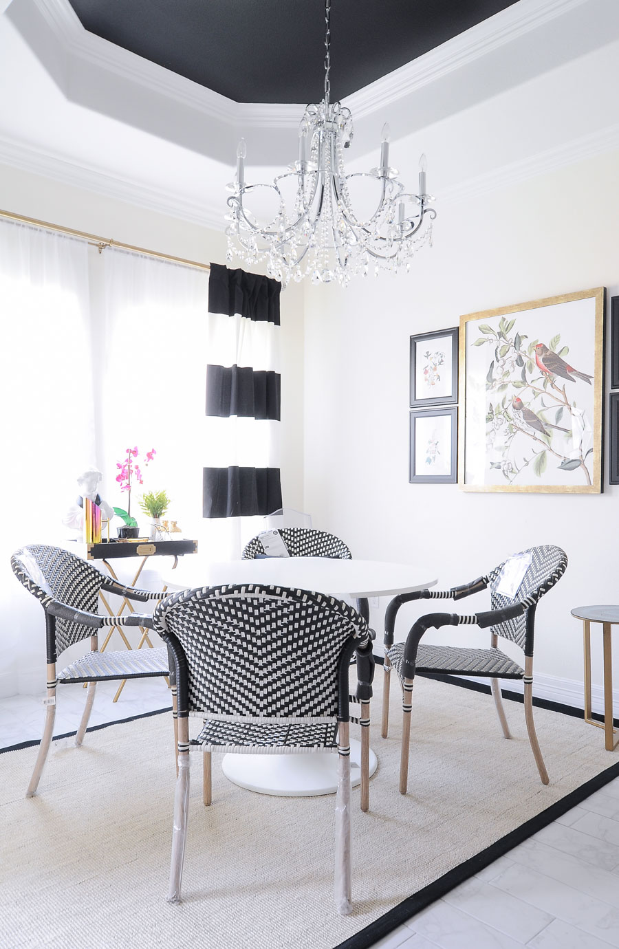 These $44 Parisian Dining Room Chairs look amazing in this small dining space decorated in bold black and white.