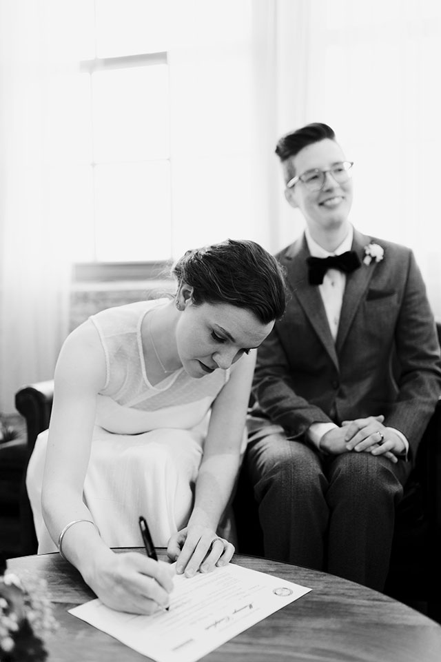 Signing the papers | Photography by Jessica Holleque