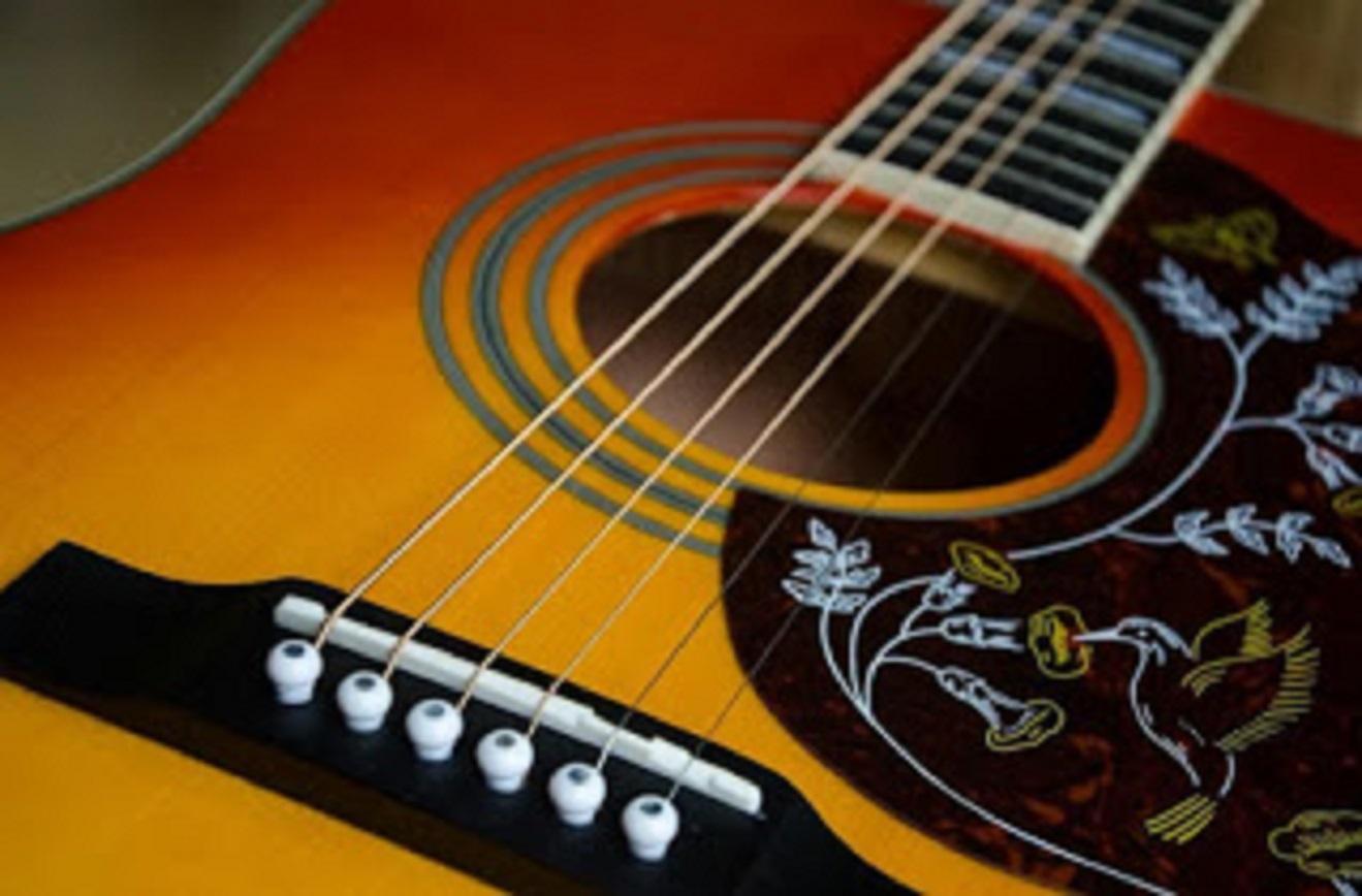 cara agar suara gitar bagus empuk
