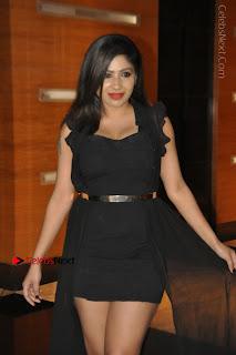 Telugu Actress Model Madhulagna Das Latest Spicy Stills in Black Short Dress  0008.JPG
