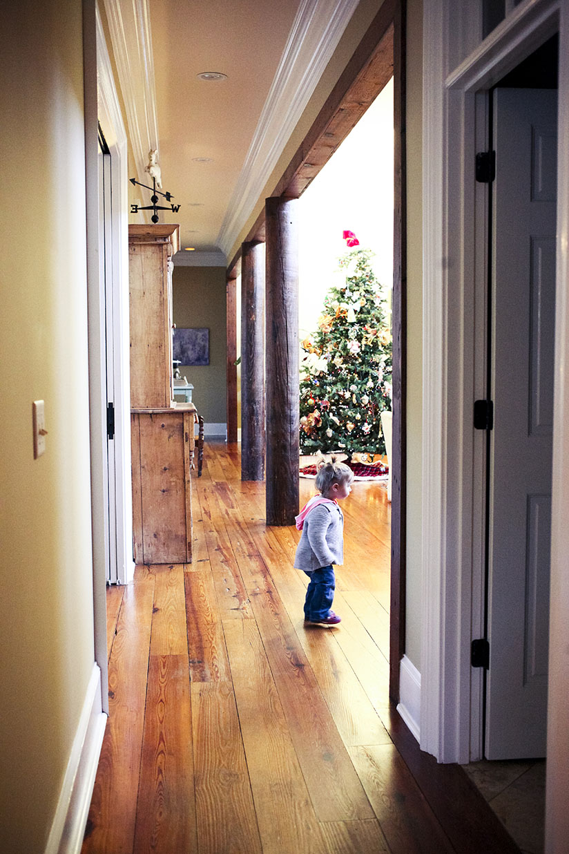 Little girl looking at Christmas decor