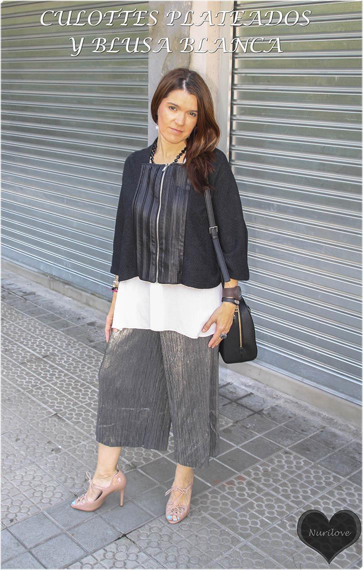 look elegante y sofisticado de culottes plateados con blusa blanca