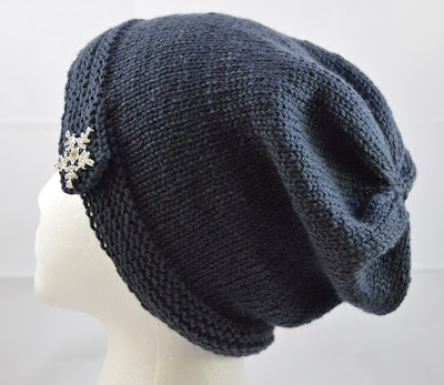 hand knit slouchy hat with rhinestone snowflake button