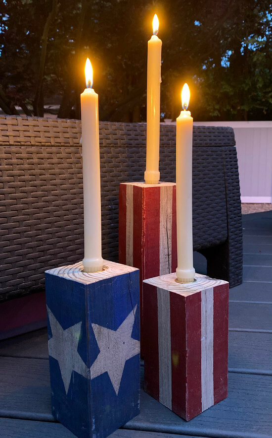 Americana candles with white tapers, lit