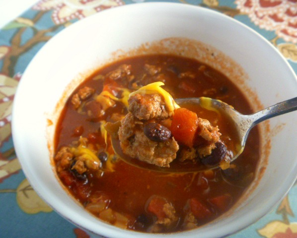 Spicy Turkey Chili:  Ground turkey along with black beans and a few pantry staples is all you need to make a batch of the BEST TASTING, healthier version of chili.  - Slice of Southern