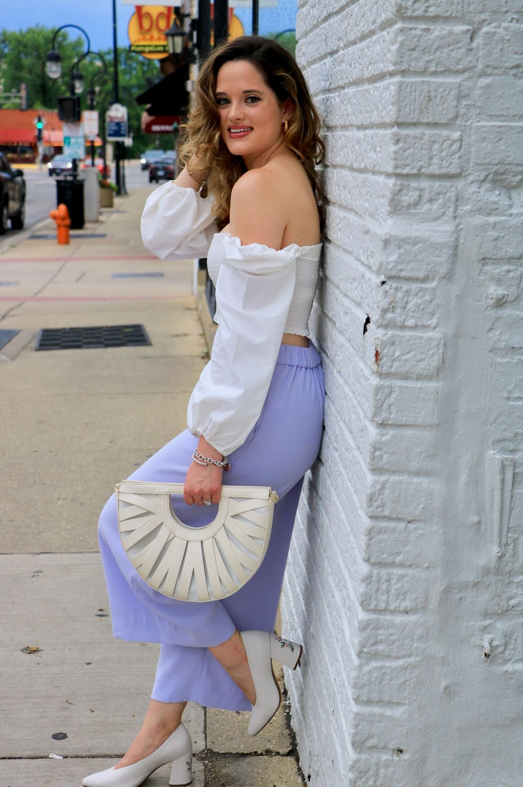 Nyc fashion blogger Kathleen Harper wearing a white Aritzia crop top.