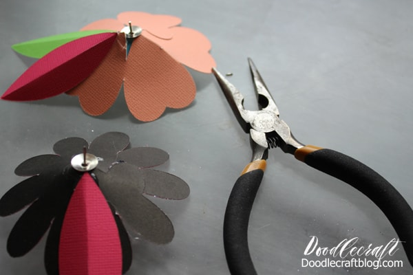 Use wire cutting pliers to clip the tip of the thumbtack off each 3D cardstock paper flower.