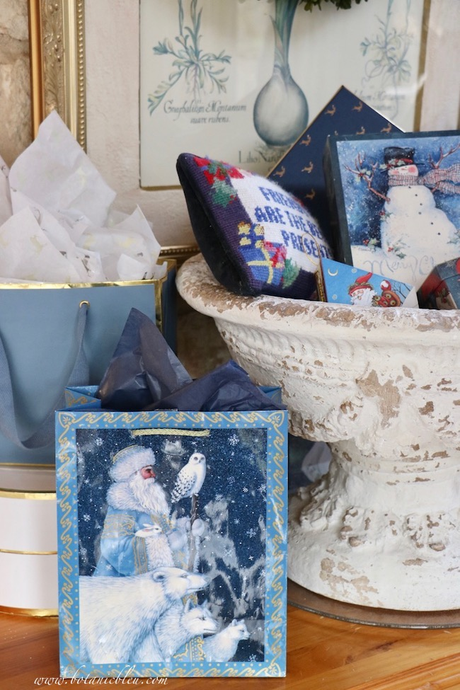 French country blue Christmas presents displayed on beautiful Christmas boxes used as risers