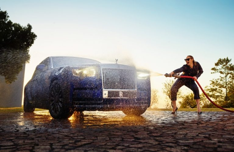 Actress Gwendoline Christie poses with Rolls-Royce Phantom