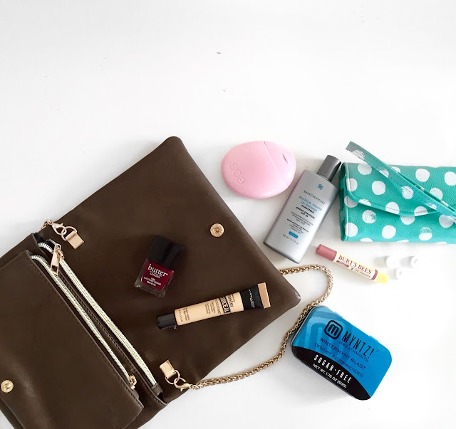 What is in my purse: my purse essentials. Butter London nail polish, Maybelline concealer, Burts Bees, and Skinceuticals