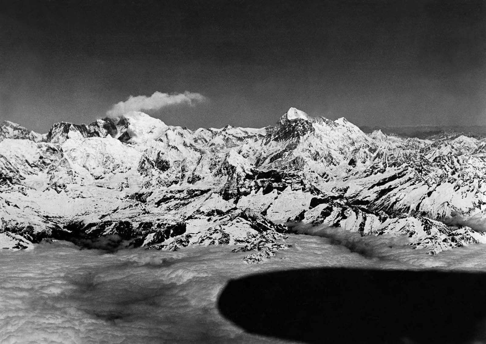 The expedition begins its return journey from Everest (left) and Makalu (right).