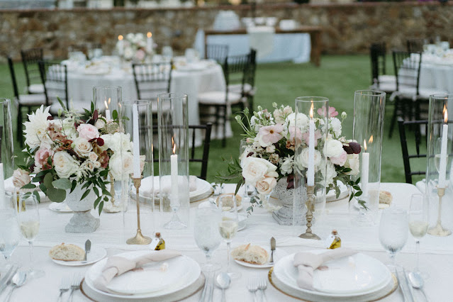 centerpieces and candles on long table