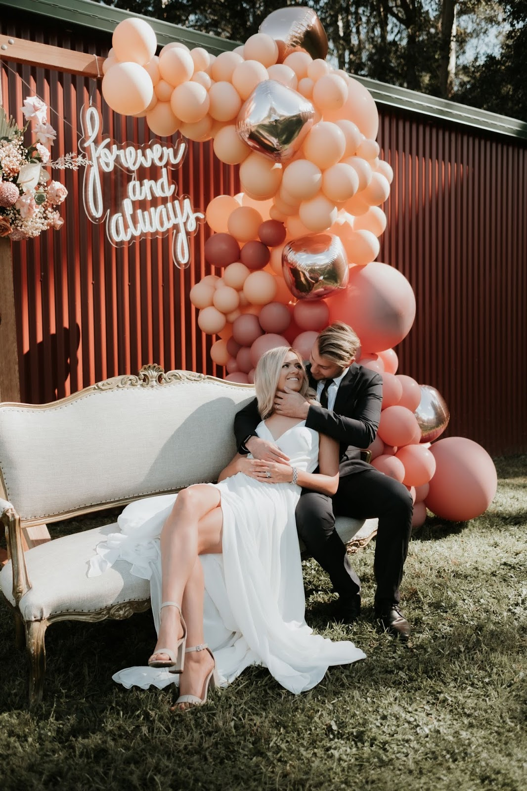 barefoot and soul photography balloon garand neon sign florals bridal gowns
