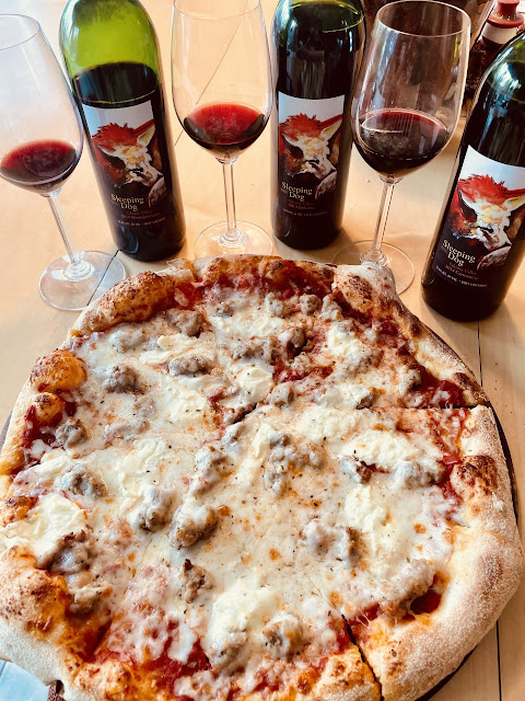Sausage ricotta pizza paired with Sleeping Dog Wines