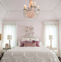 Peach pink wall color for bright bedroom design and lavender pillows