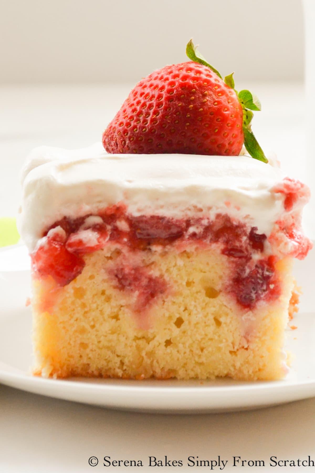 Strawberry Shortcake Poke Cake slice photo on a white plate.