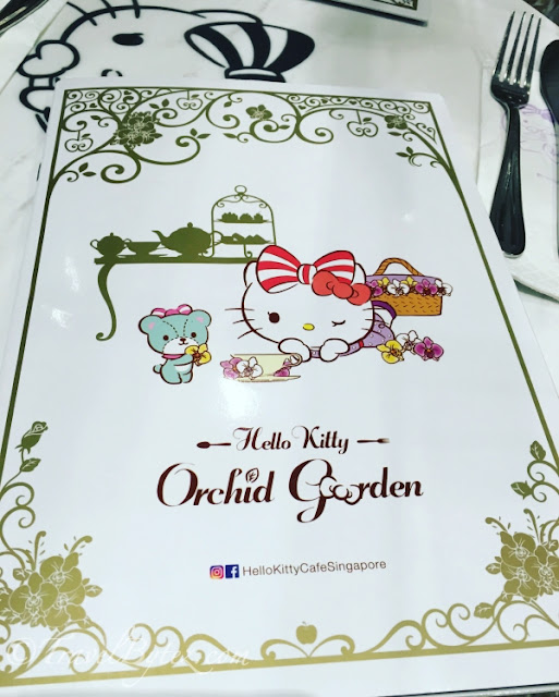 The adorable menu was on the table which had the Hello Kitty emblem.