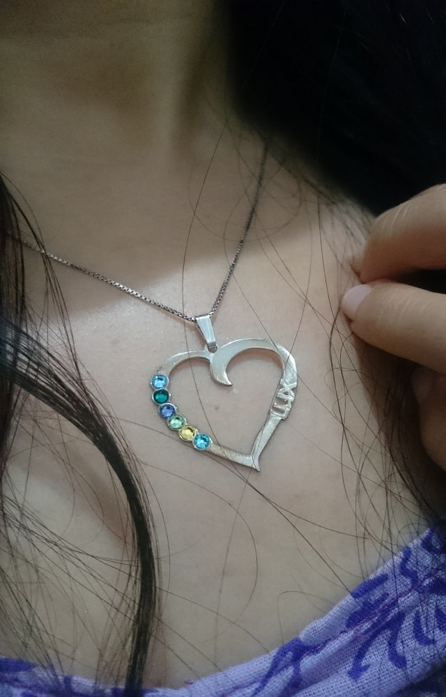 pretty silver necklace with birthstone and name