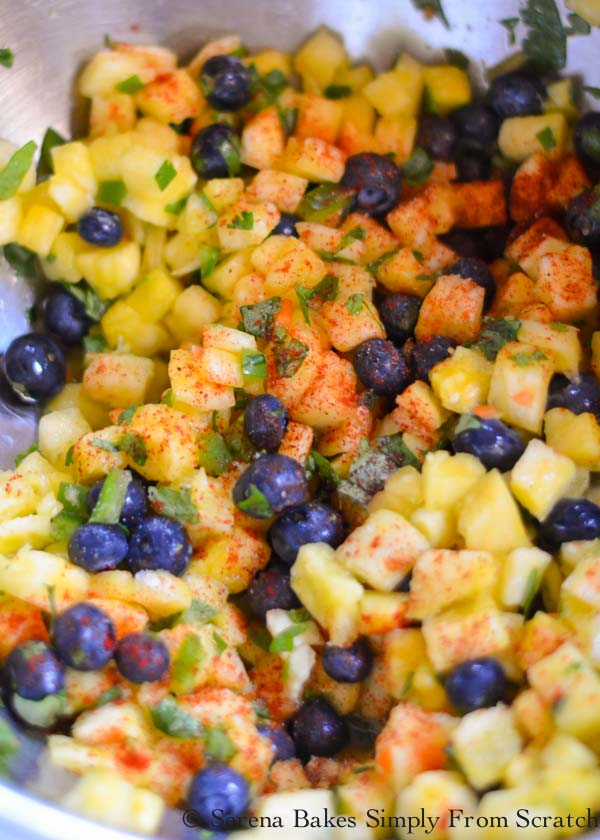 Pineapple Blueberry Salsa add chili powder, smoked paprika, garlic, and salt.