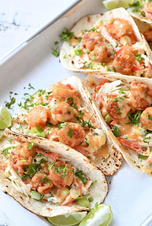 closer look at bang bang shrimp tacos with chopped cilantro