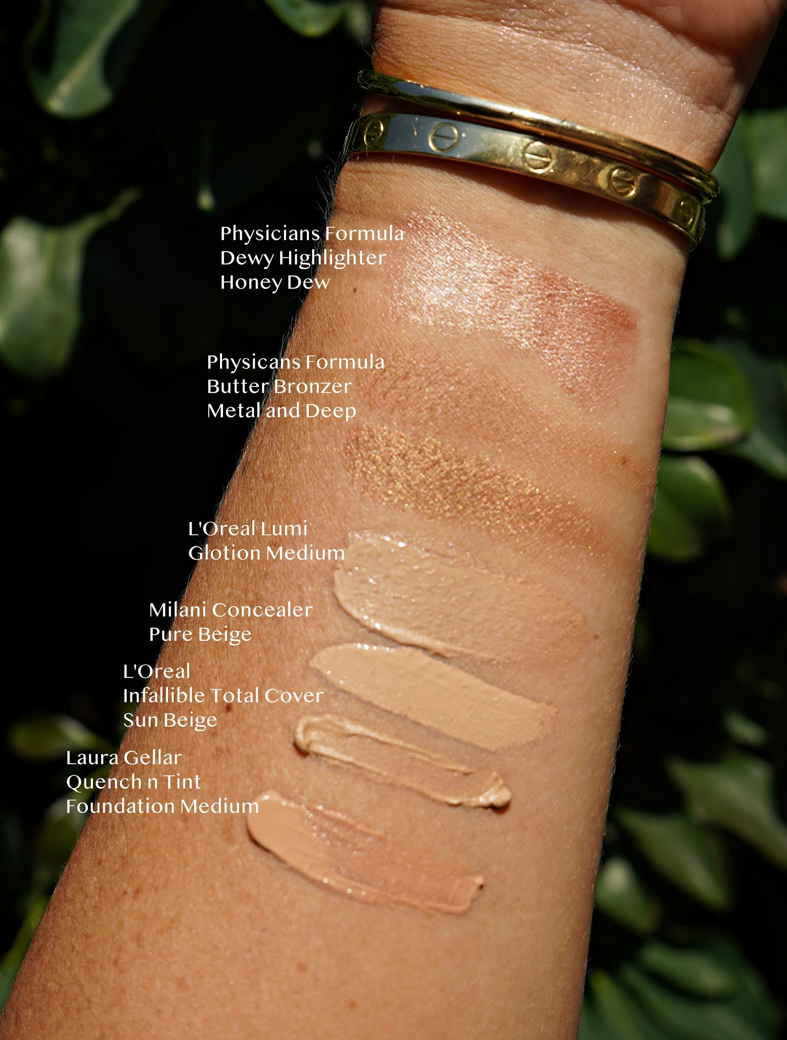 face and base makeup swatches in an arm