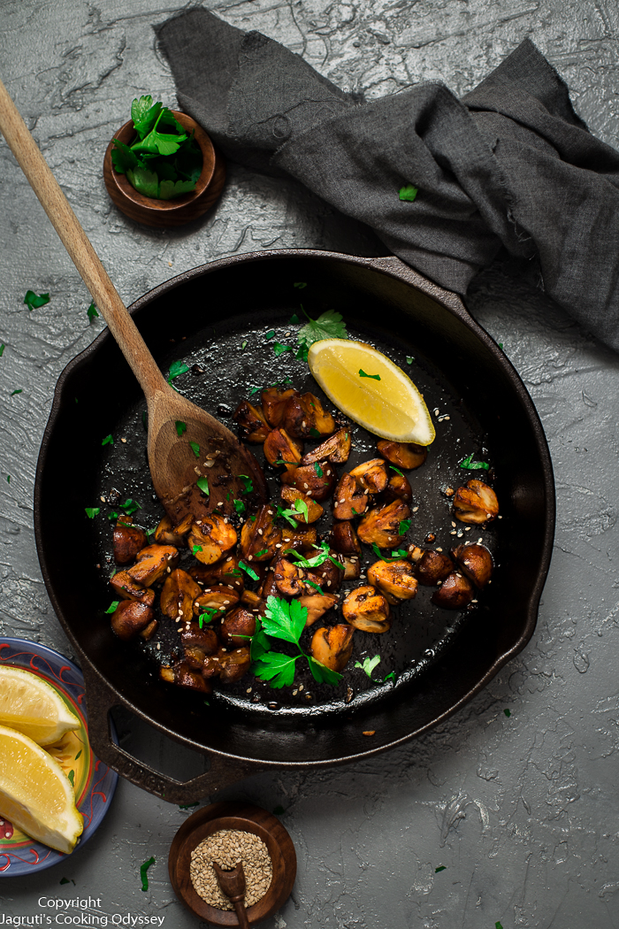 Soy and garlic mushroom stir fry served in a round cast iron skillet