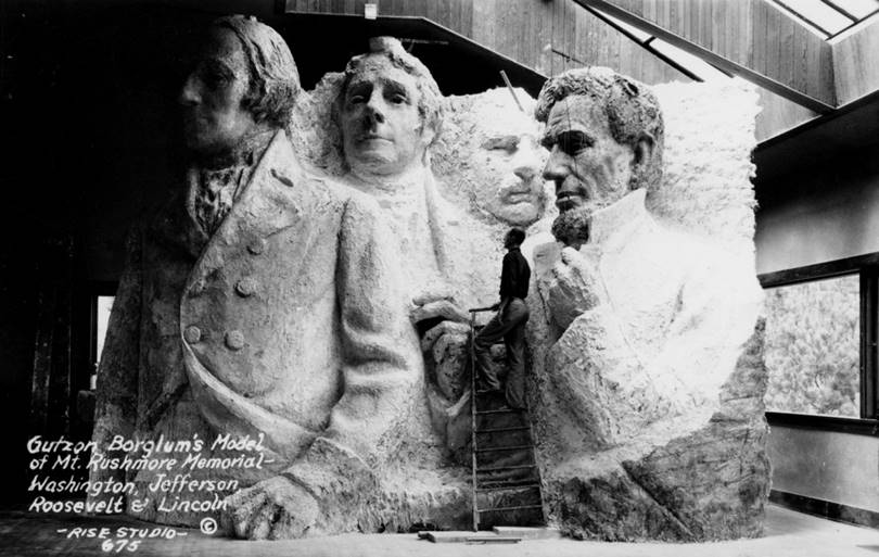 "Model of the future national memorial ""Mount Rushmore"", which is a bas-relief carved in rock containing sculptures of four US presidents, in the workshop of sculptor Gutzon Borglum, circa 1925"