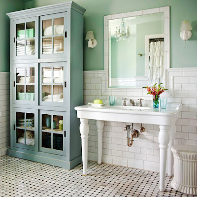 Cottage small bathroom with green walls and blue cabinet