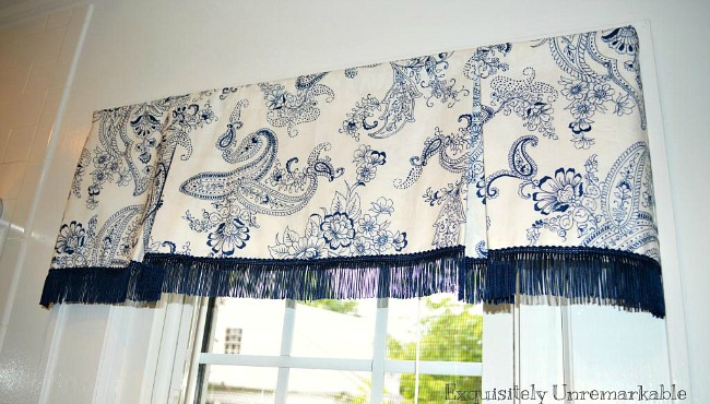 Blue and white Box Pleat Valance with blue fringe on bathroom window