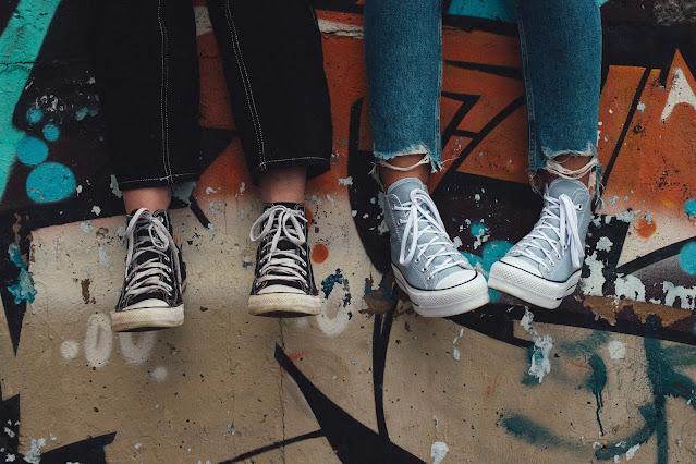 teenagers legs dangling; Photo by Aedrian on Unsplash