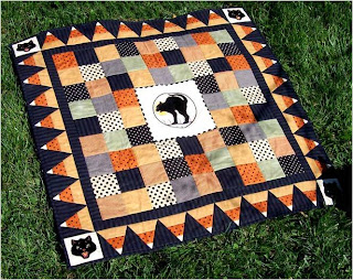 Quilt inspiration free pattern day halloween by the light of the moon quilt with candy corn border free pattern by elizabeth cecchettini for babylock pdf download maxwellsz