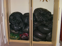 clothes in black bin liners for charity shop collection