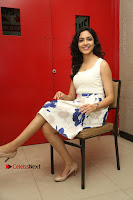 Actress Ritu Varma Stills in White Floral Short Dress at Kesava Movie Success Meet .COM 0229.JPG