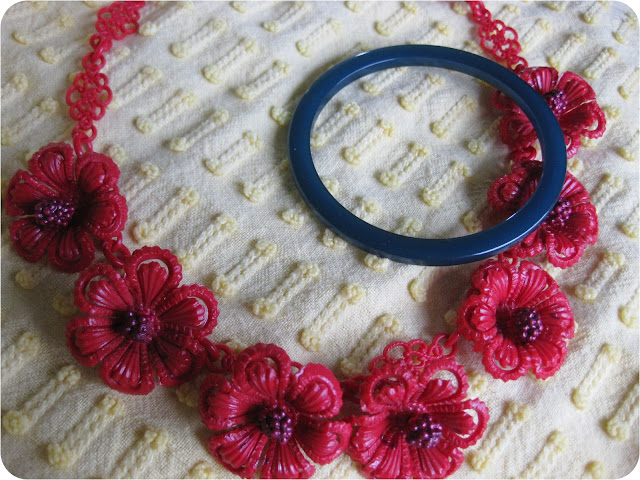 blue bakelite bangle bracelet and red celluloid vintage flower necklave from Va-Voom Vintage