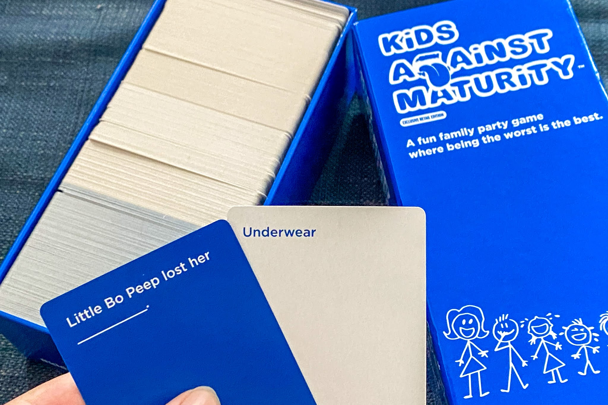 The Kids Against Maturity Card game box with a sample question and answer saying: Little Bo Peep lost her ... underwear