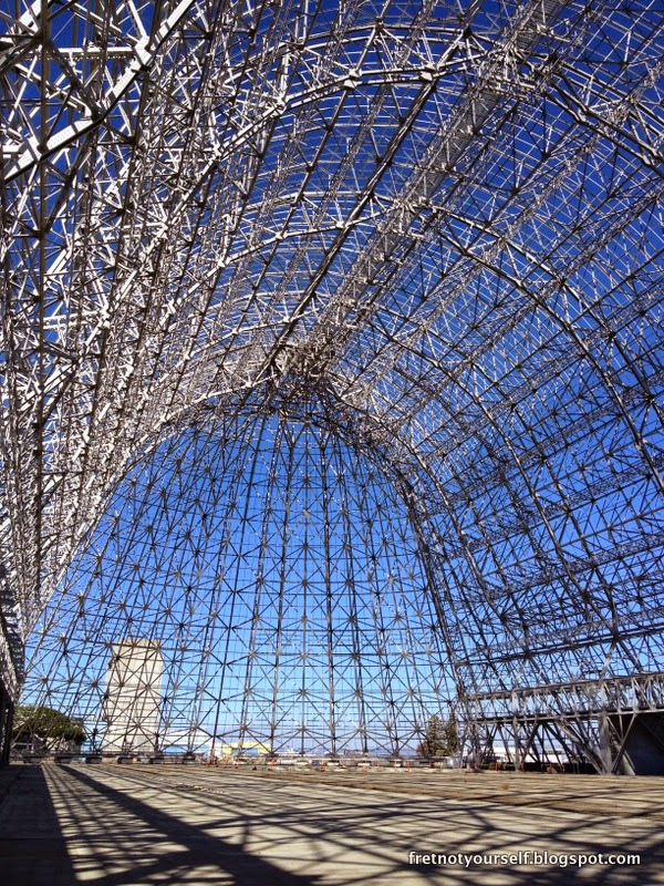 The metal skeletal support structure of Hangar One is visible from inside the Hangar.