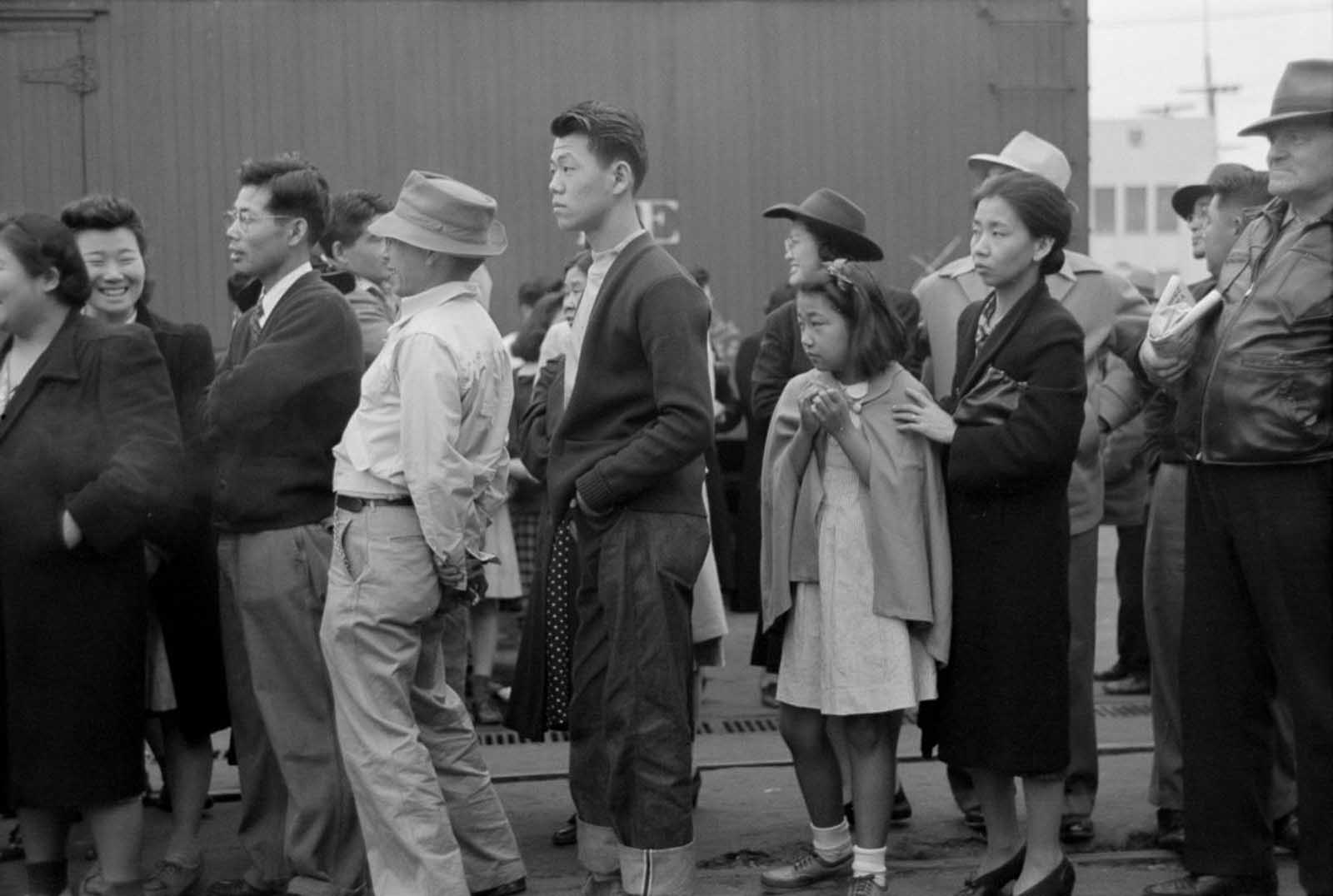 Evacuees in Los Angeles watch as trains carry their friends and relatives to Owens Valley.