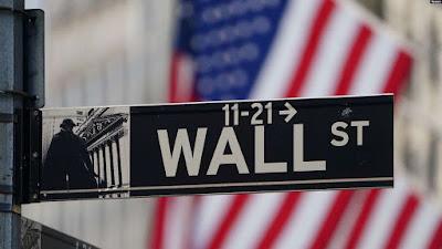 Saham Wall Street naik sedikit, Selasa pagi (5/1), saat pasar memantau tren virus corona yang memburuk di seputar Amerika. (Foto: ilustrasi).
