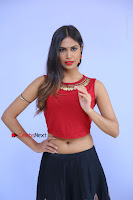 Telugu Actress Nishi Ganda Stills in Red Blouse and Black Skirt at Tik Tak Telugu Movie Audio Launch .COM 0004.JPG