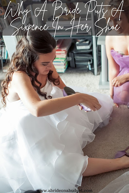Have you ever wondered WHY a bride puts a sixpence in her shoe? Find out the reason from www.abrideonabudget.com.