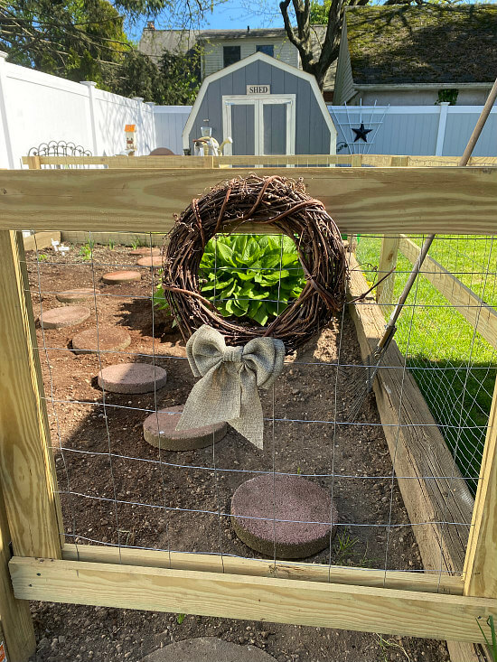 garden fence with grapevine wreath