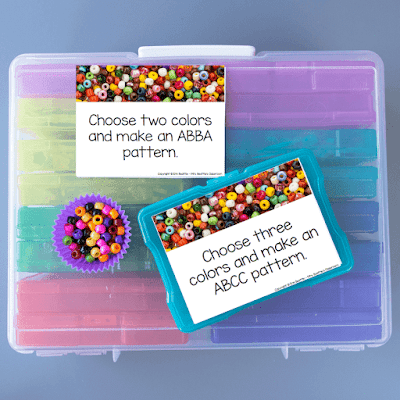 Photo of beads and task cards on top of a large container of task card bins.