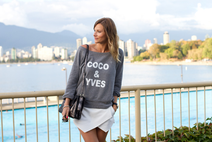 Vancouver Fashion Blogger, Alison Hutchinson, wearing a grey sweater from XO Bella, white Zara skort, off-white Converse All Star, BOtkier Valentina Bag, and Sass & Bide Sunglasses