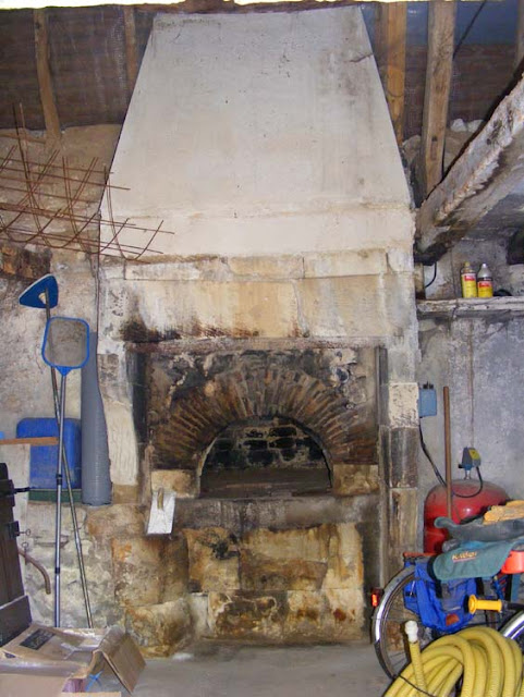 Bread oven in a barn, Vienne, France. Photo by Loire Valley Time Travel.