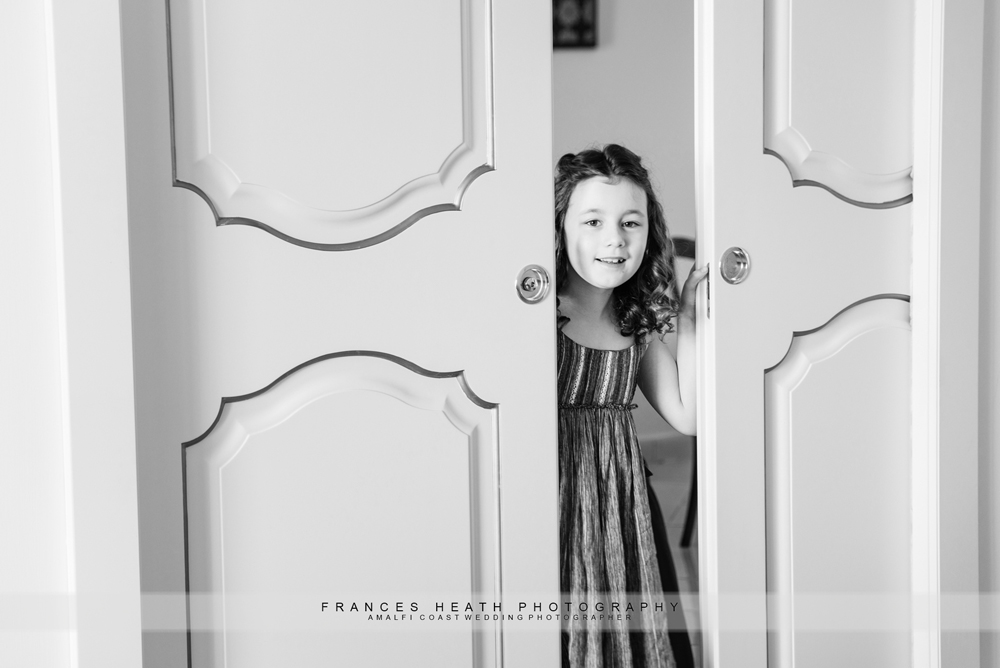 Flower girl looking through doors