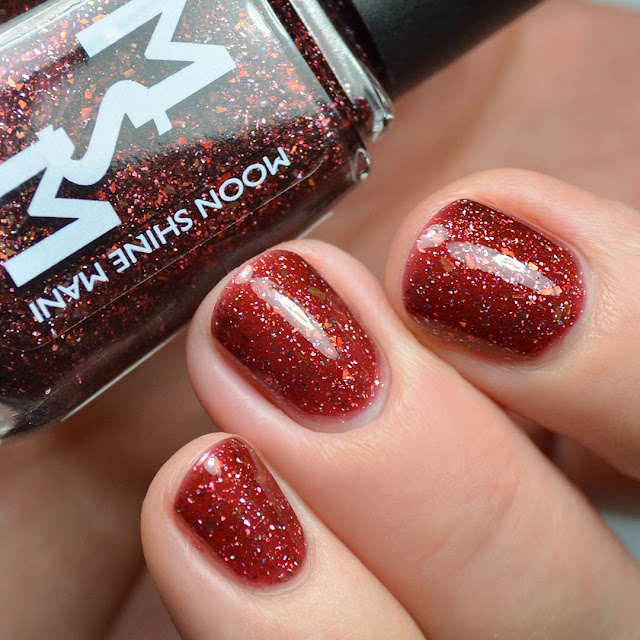brown jelly nail polish with flakies swatch