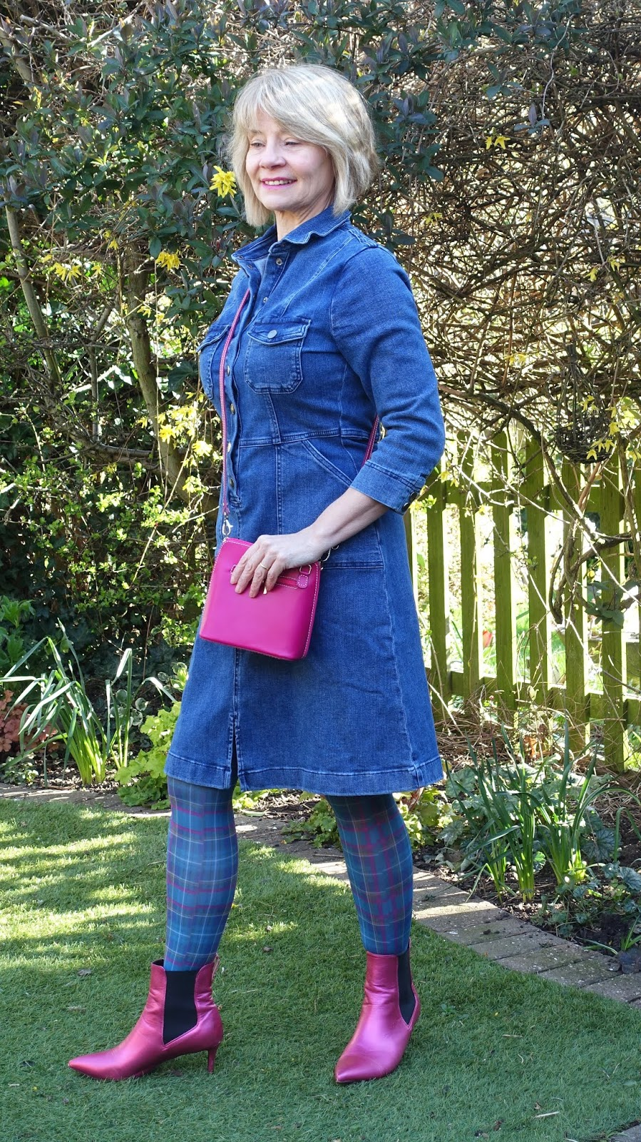 Tartan tights and pink accessories worn with a denim dress by Sosandar for spring-summer 2020 by over-50s style blogger Gail Hanlon