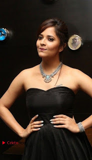 Telugu Anchor Actress Anasuya Bharadwa Stills in Strap Less Black Long Dress at Winner Pre Release Function  0004.jpg
