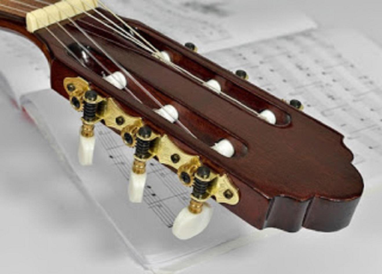 apakah gitar klasik bisa pakai senar baja