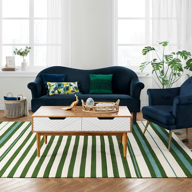 green stripe area rug with blue sofa and chair